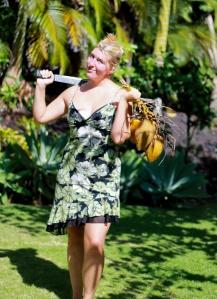 Lauren in Hawaii with coconuts and machete