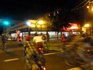 Pedalpalooza bikers follow Peter Piper across MLK Blvd. during this year's Grunge Ride.