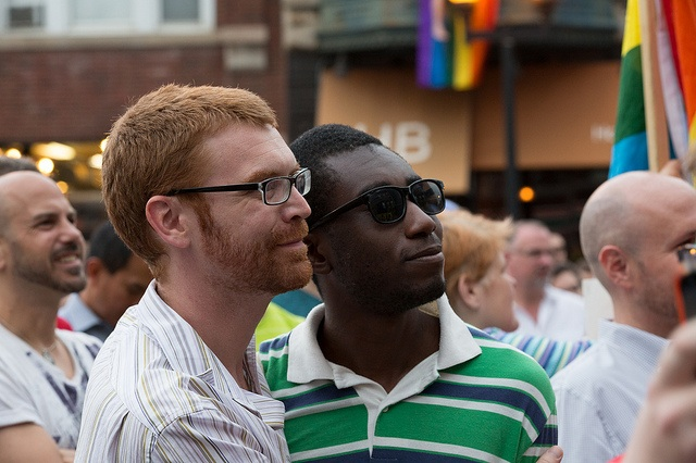 Couple at Gay Pride in Chicago; image courtesy of chicagopublicmedia via Flickr.